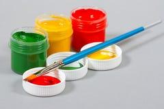 Set of art gouache paints and brush Stock Photo