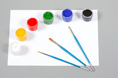 Set of art gouache paints and brushes and paper Stock Image