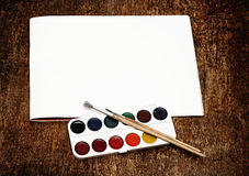 Set of art paints and brushes to paint and paper Stock Photo