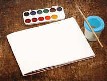 Set of art paints and brushes to paint and paper Royalty Free Stock Photo
