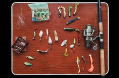 Set of artificial baits for pike fishing lies on table Stock Image