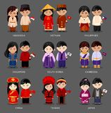 Set of asian pairs dressed in different national costumes. royalty free illustration