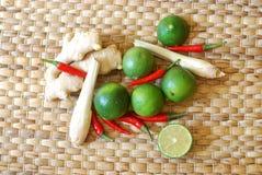 Set of asian spices: kaffir limes, lemongrass, bird`s eye chilis, ginger. royalty free stock image
