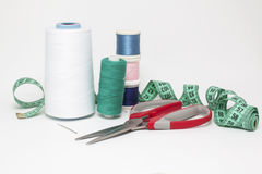 Set for aspiring seamstress. Color thread on white canvas. Photo royalty free stock photos