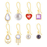 Set of assorted golden earrings. With gemstones and pearls Royalty Free Stock Images