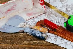Set of assorted plaster tools and spatula on construction and renovation concept. Set of assorted plaster tools and spatula on background old wood. Construction Royalty Free Stock Image