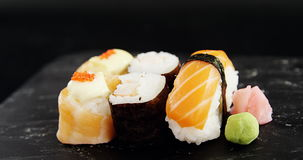 Set of assorted sushi served on gray stone slate. Close-up of set of assorted sushi served on gray stone slate stock video footage
