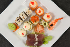 Set of assorted sushi served in a white plate Stock Photos