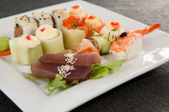Set of assorted sushi served in a white plate Royalty Free Stock Photos
