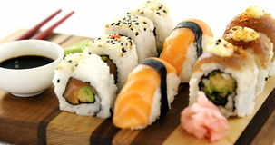 Set of assorted sushi served on wooden tray stock footage