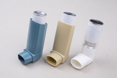 Set of asthma inhalers. On a gray background Royalty Free Stock Photography