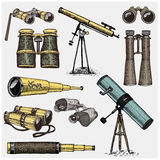 Set of astronomical instruments, telescopes oculars and binoculars, quadrant, sextant engraved in vintage hand drawn. Or wood cut style , old sketch glasses Royalty Free Stock Photography