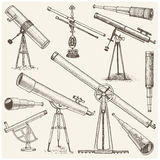 Set of astronomical instruments, telescopes oculars and binoculars, quadrant, sextant engraved in vintage hand drawn. Or wood cut style , old sketch glasses Royalty Free Stock Image