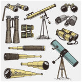 Set of astronomical instruments, telescopes oculars and binoculars, quadrant, sextant engraved in vintage hand drawn. Or wood cut style , old sketch glasses Royalty Free Stock Photo