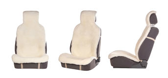 Set of auto seats under white cover Stock Photo