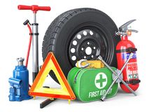 A set of automotive accessories. Spare wheel, fire extinguisher,. First aid kit, emergency warning triangle, jack, tow rope, wheel wrench, pump. Objects  on Stock Photo