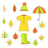 Set autumn items from leaves, rubber boots, raincoat, hat umbrella. Set of autumn items from leaves, rubber boots, raincoat, hat and umbrella Stock Photography