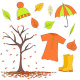 Set autumn items from leaves, rubber boots, raincoat, hat umbrella. Set of autumn items from leaves, rubber boots, raincoat, hat and umbrella Royalty Free Stock Image