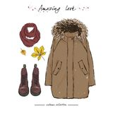 A set of autumn outfit with accessories: brown parka jacket, cla. Ret boots on laces, a warm scarf and autumn leaves. Hand drawn  illustration on a white Stock Images
