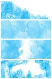 Set av blåa den målade vattenfärgabstrakt begrepphanden arkivbild