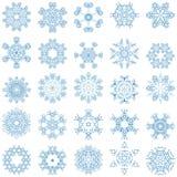 Set av blåa vektorsnowflakes Arkivfoton