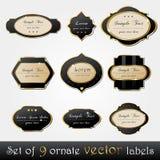Set av eleganta, mörka guld-inramninga etiketter Arkivfoton