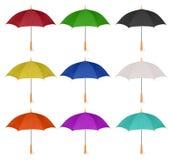 Set av färgrika den isolerade paraplysymbolen Arkivbilder