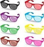 Set av färgsolglasögon Arkivfoto