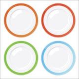 Set av fyra clean plattor med kulöra kanter Arkivfoto