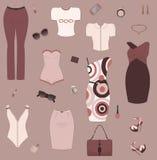 Set av kvinnakläder och tillbehör. Arkivbild