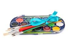 Set av målarfärger och borstar Royaltyfria Bilder