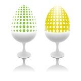 Set av ovanliga ägg i äggkoppar Royaltyfria Bilder