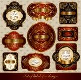 Set av röd-guld- etiketter Arkivfoto