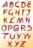 Set av röda dekorativa bokstäver Arkivbild