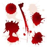 Set av splattered blodfläckar Arkivbild