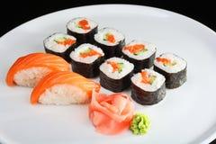 Set av sushi och rullar Arkivfoto