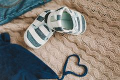 Top view fashion trendy look of baby clothes, fashion concept.  A pair of baby boy shoes. Set of baby clothes and accessories on light background, flat lay royalty free stock image