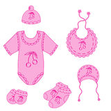 122a set of baby clothes for girl in vector. A set of baby clothes for boy in vector EPS 10 stock illustration