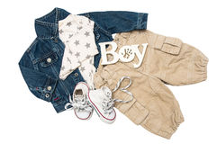 Set of baby clothes for a little boy on a white background. Sneakers, pants, jacket royalty free stock photography