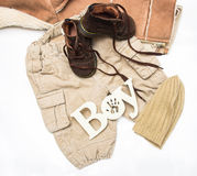 Set of baby clothes for a little boy on a white background. Stock Images