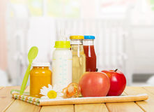 Set of baby food and fresh fruit on the child's Royalty Free Stock Photo