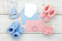Set of baby girl and boy booties and greeting card form. Top view. Set of baby girl and boy booties and greeting card form Royalty Free Stock Images