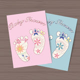 Set of baby showers with feet on wooden background Stock Images
