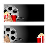 Set backgrounds for cinema. Reel of film with popcorn and a drink on a black background.set backgrounds for cinema Stock Photo