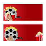 Set backgrounds for cinema. Reel of film with popcorn and a drink on a red  background.set backgrounds for cinema Stock Image