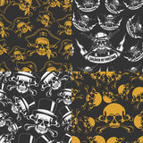 Set of backgrounds Seamless emblems of skulls Royalty Free Stock Photography