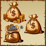 Set of bags with gold and silver coins Royalty Free Stock Image