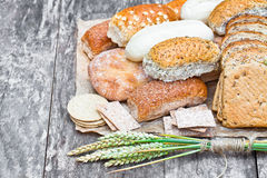 Set of bakery products on the old wooden table Stock Image