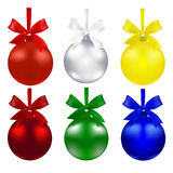 Set of balls. Christmas decorations. The symbols of the New Year. Red, green, silver, blue and yellow colors with bows Stock Photos