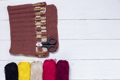 Set of bamboo crochet hooks, color sticker and colorful yarn royalty free stock photography